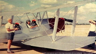 Frame grab from tiny 8mm movie film as we had no actual photos. Lofty Harris in cockpit with owner/pilot (parachutist ex Qld Parachute Club) about to get into rear pilot seat. Dual controls.