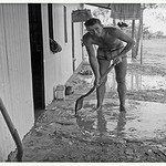 Note my Ferris radio. Good receeption outback. Jim Plaw removes mud after the two days of flood.